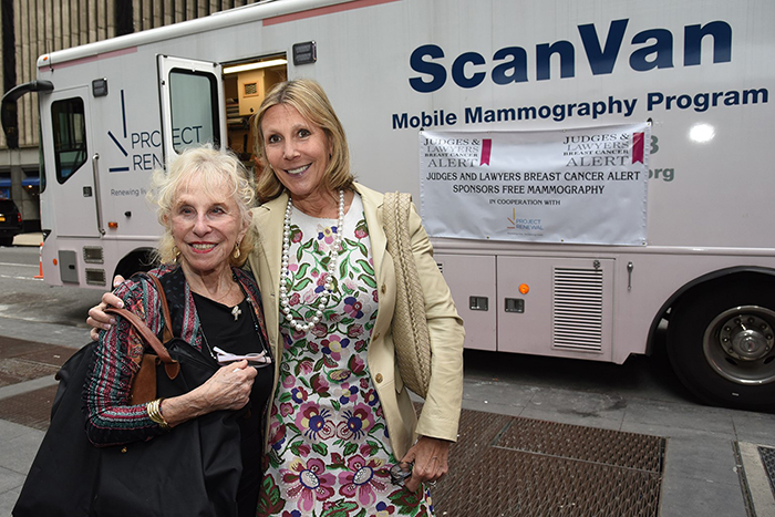 Hon. Sondra Miller and Faith Miller in font of a mobile scan van